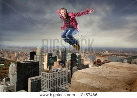 man listening music and jumping over NY city