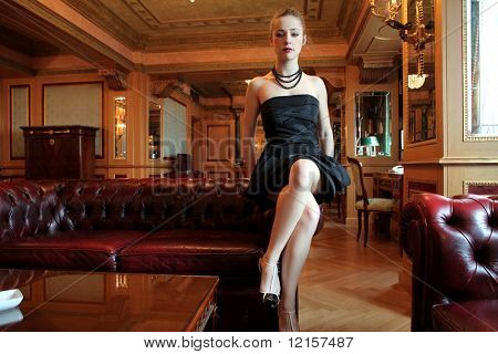beautiful woman seated in a luxury interior