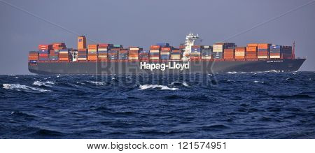BAB-EL-MANDEB STRAIT  GULF OF ADEN  ?? FEB 05, 2016: Hapag-Lloyd Container Ship Ulsan Express in high seas. She has 366m length overall and beam of 48m. Her gross tonnage is 142295 tons.