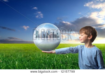 child holding a city inside a sphere