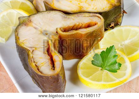 Smoked sturgeon fillet on a  platter