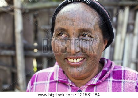 SAW, MYANMAR - DECEMBER 10, 2015: Photo of a Chin tribe tattooed faced woman (Yin Duu tribe). Also known as the Kakis they are a number of Tibeto-Burman tribal people.