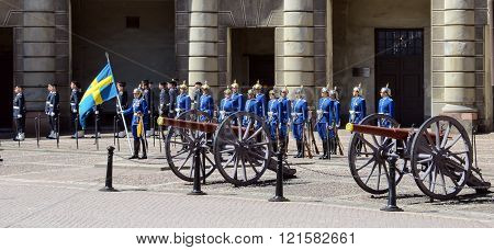 Stockholm, Sweden - May 26, 2014: A guard carries the Flag of Sweden during the Changing of the Royal Guard at the Royal Palace