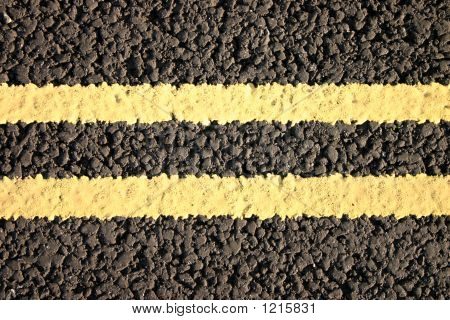 Close Up Of Double Yellow Lines.