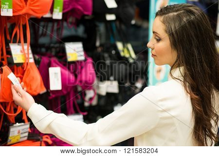 Woman reading a price tag in a shop
