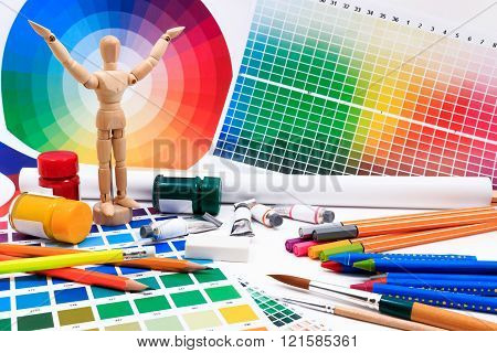 A set of tools for creative art work with abstract colored palette guide.
