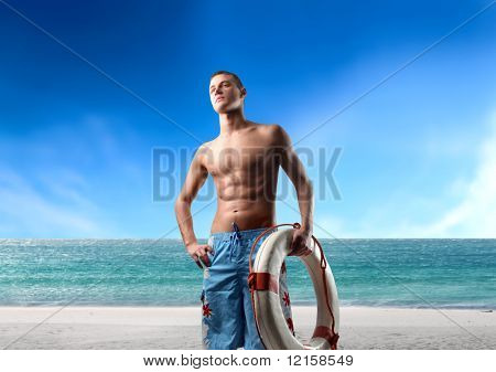 Portrait of a life guard carrying a lifesaver
