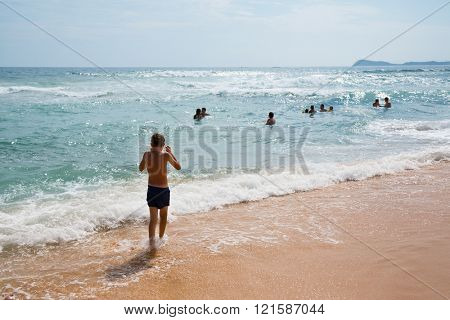 People swim in the sea on a hot summer day. Coast of the Sea of Japan.