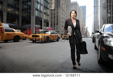 Portrait of a businesswoman walking on a city street
