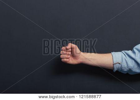 Fist against blackboard