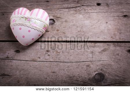 Pink Decorative  Heart  On Aged Wooden Background.