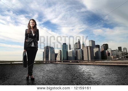 Portrait of a businesswoman with cityscape on the background