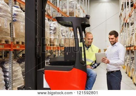 wholesale, logistic, loading, shipment and people concept - loader on forklift and businessman with tablet pc computer at warehouse