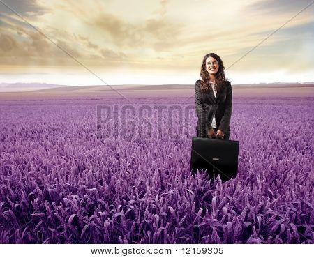 Portrait of a businesswoman standing on a purple meadow