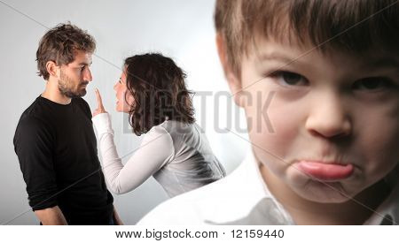 Young couple quarreling and closeup to a sad child