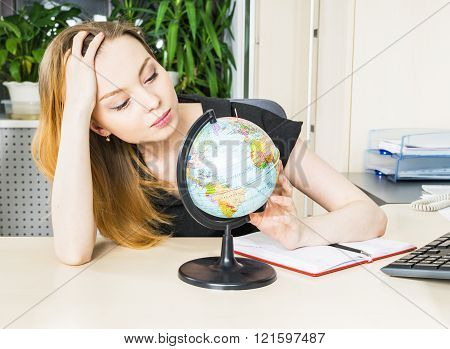 Woman In Office With Globe