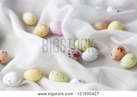 chocolate specled Easter eggs in gauze fabric folds