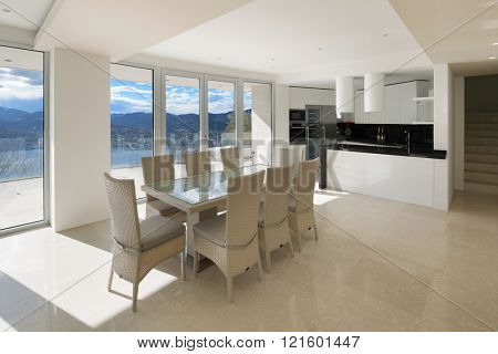 Interior, wide open space with kitchen and dining table