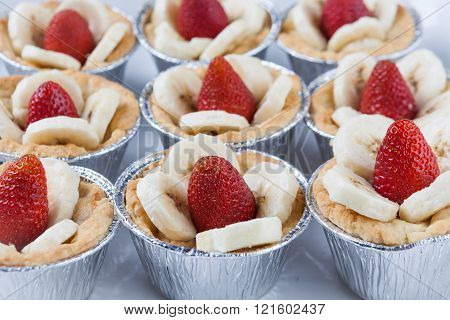 Closeup of tartlets with strawberries and bananas