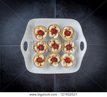 Nine Tartlets On White Dish