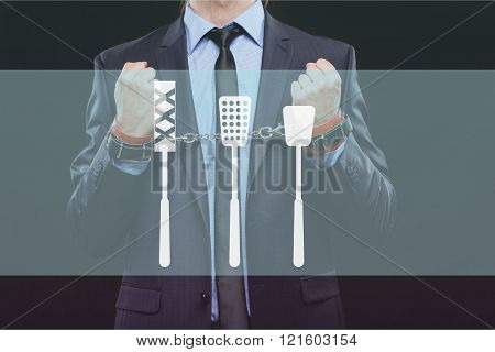 man in a business suit with chained hands. handcuffs for sex games. concept of erotic entertainment.