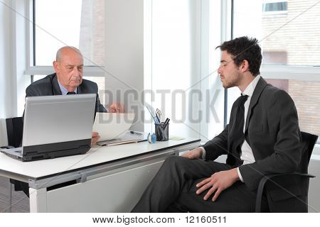 Young businessman in an interview with an older one