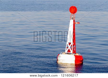Red White Moored Buoy In Blue Ocean