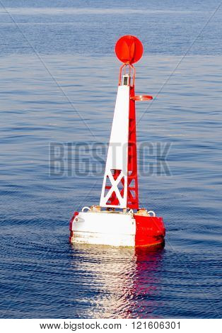 red white moored buoy in the sea