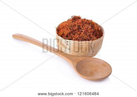 dried safflower in basket on white background