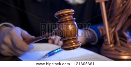 Judge. Male judge in a courtroom striking the gavel