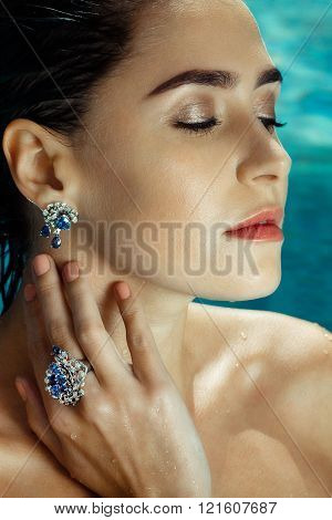 Woman at Pool wearing Sapphire Jewelry