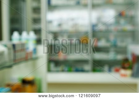Blurred pharmacy drugstore shelves and counter