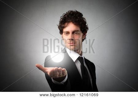 Businessman holding a light in his hand
