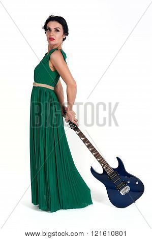 Pretty woman in long dress with guitar