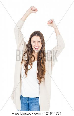 Triumphant woman raising fist on white background