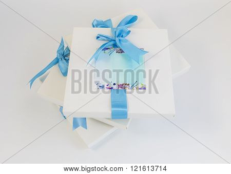 Gift Boxes With Blue Ribbons On A White Background