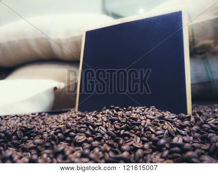Blank Chalkboard Menu sign with Roasted Coffee beans background Wholesale