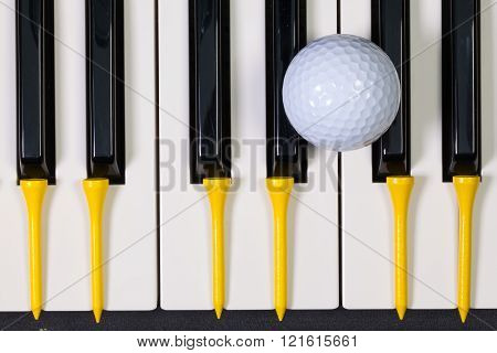 Piano Keyboard And Different Golf Balls And Tees