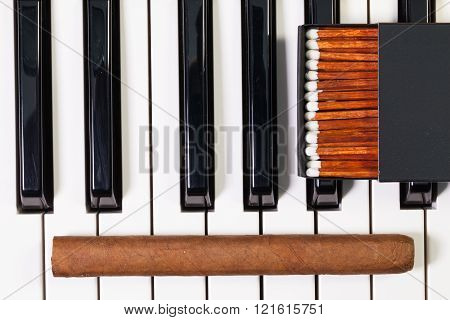 Piano Keyboard And Luxury Cigar