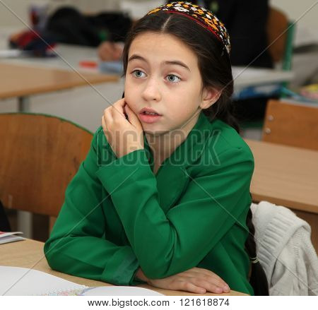 Ashgabad Turkmenistan - November 4 2014. Portrait of an unknown schoolgirl in the classroom. November 4 2014. In schools of Turkmenistan annually trains about 900 thousand children