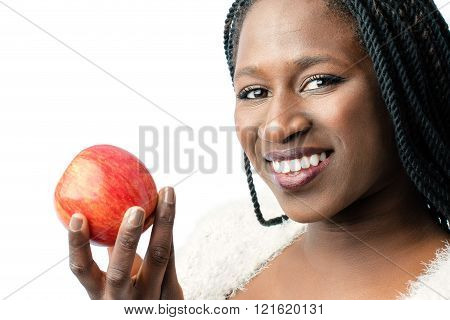 Attractive african girl holding red apple.