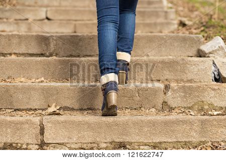 Womans Legs In Winter Boots Stepping On Stairs