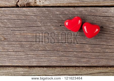 Two candy hearts over wood. Valentines day background. Top view with copy space