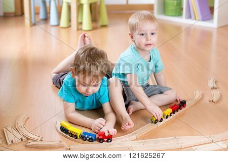 kids boys play with railroad and trains indoor, learning and daycare