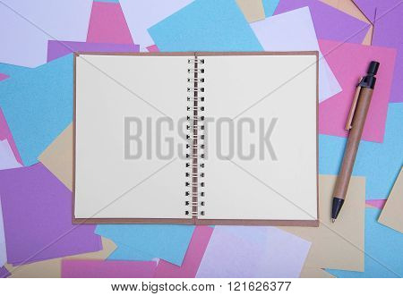Open notebook on the background of colored stickers.