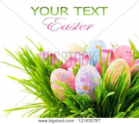 Easter colorful decorated eggs on green spring grass isolated on white background. Beautiful border design