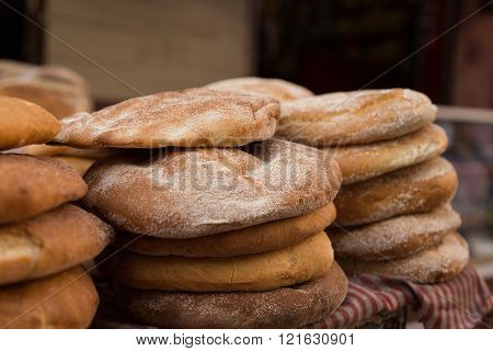 stacked round bread in the market of Taroudant, Morocco