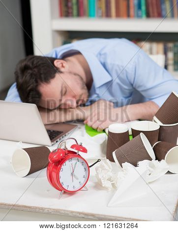 Tired male freelancer in coworking space