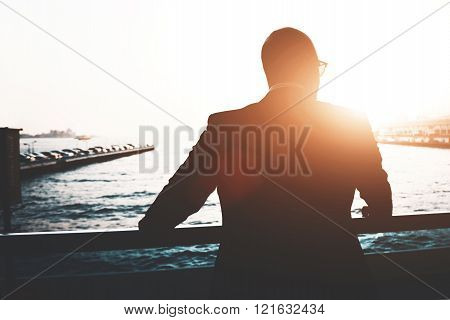 Back view of a young businessman is enjoying view and rest after meeting during his business trip.