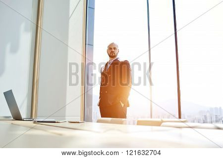 Young male government worker is waiting for the beginning of important meeting